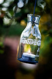 Lantern hanging from appletree Stock Photo