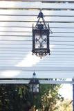 Lantern hanging in the arbor. Decorative lantern hanging in the arbor Royalty Free Stock Photo