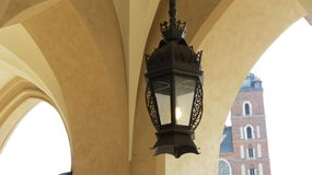 Lantern. Hanging in an arch in central Krakow Royalty Free Stock Photography