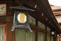 Lantern hanging under the eaves Stock Photography