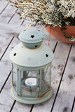 Lantern with heather. On a wooden table Stock Photo