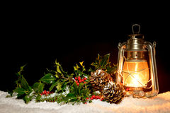 Lantern with holly and ivy Stock Photography