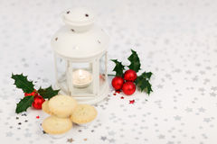 Lantern, holly and mince pies Stock Photos