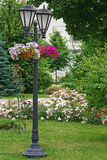 Lantern In The Summer Garden Decorated With Flowers Stock Image