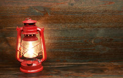 Lantern kerosene oil lamp. On wooden background Royalty Free Stock Images