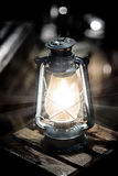Lantern lamp burning with a soft glow light Royalty Free Stock Photo
