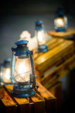 Lantern lamp burning with a soft glow light Royalty Free Stock Photography
