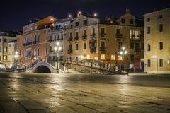 Lantern light and a bridge at night in venice, italy Stock Photo