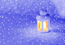 Lantern light on winter evening Royalty Free Stock Photography