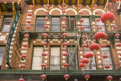 Lantern Lines. Colorful lanterns hang on a building Stock Photo