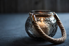Lantern with a lit candle on concrete background. With copy space Stock Photos
