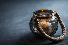 Lantern with a lit candle on concrete background. With copy space. Toned blue Stock Images