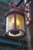 Lantern Lit. Lantern hangs lit at the entrance to the building Stock Image