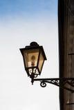 Lantern lit  on sky background. Old lantern lit  on sky background Royalty Free Stock Photo