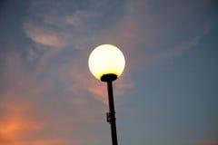 Lantern lit at sunset. Before dark Royalty Free Stock Photo