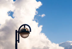 The Lantern. Lonely street lantern on the background of cloudy sky Stock Photos