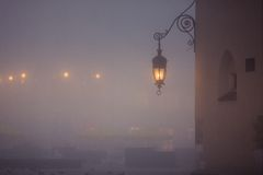Lantern on market square in Krakow at morning fog Stock Image