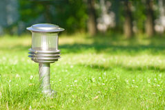 Lantern in the middle of a lawn Stock Images