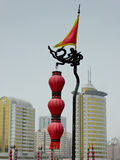 A lantern with modern buildings background Royalty Free Stock Photos