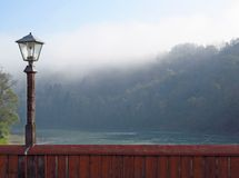 Lantern and morning fog Stock Images