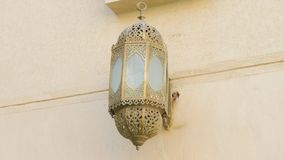 Lantern in The Mosque. A Beautiful Lantern Hangs on the Wall in the Muslim Mosque. It was Made in an Old-Fashioned Style. The lamp is decorated with an ornament stock footage