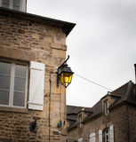 Lantern mounted in the wall of a house, Dinan, Cotes-D'Armor, Br. Ittany, France Stock Photo