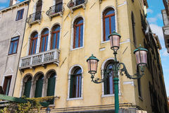 Lantern near a beautiful mansion in Venice Royalty Free Stock Photos