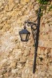 Lantern. Old lantern on dirty wall Stock Image