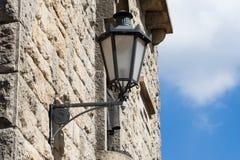 Lantern on the old wall in San Marino Royalty Free Stock Image