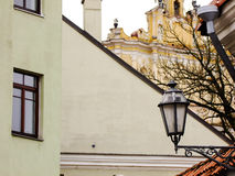 Lantern in Oldtown. Decorative Lantern hanging on the Wall of old Building standing in the Oldtown Stock Image
