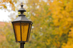 Lantern in the park. Autumn royalty free stock photography