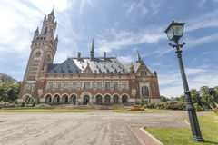 Lantern and the peace palace. Lantern and the front view of the Peace Palace, Seat of the International Court of Justice, Principal organ of the United Nations royalty free stock images