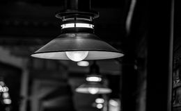 Lantern in pub in black and white. Hanging lantern in pub in black and white Royalty Free Stock Image