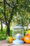 Lantern and pumpkins on wooden table Royalty Free Stock Photos