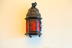 Lantern with red glass on the wall. A lantern with red glass in hanged to the wall Royalty Free Stock Photography