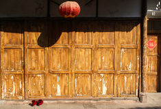 Lantern, red shoes, and wood doors. In Chengdu Stock Photo