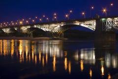 Lantern reflexions at river. Warsaw Poniatowski bridge lantern reflexions at Vistula river night scene Royalty Free Stock Photo