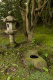 Lantern and rock pond in japaneese garden Sankei-en Stock Image