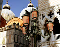 Lantern at the San Marco Square in Venice. San Marco  Basilica in background.  Italy Stock Photos