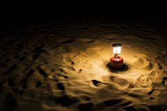 Lantern on sand dune Royalty Free Stock Photo