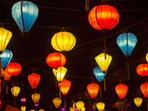 Lantern seller in the streets of ancient town of Hoi An in Central Vietnam, colorful lanterns hanging everywhere creating a great. Atmosphere, spring time royalty free stock photography