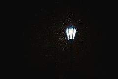 The lantern shines in the night sky. The night lighting. On a black background Royalty Free Stock Photography
