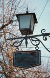Lantern with a signboard Royalty Free Stock Photos