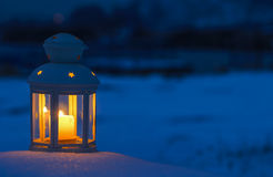 Lantern on snow Stock Photography