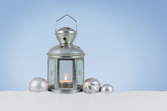Lantern in the snow stock photos