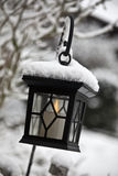Lantern in the snow Stock Image
