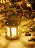 Lantern on snow Royalty Free Stock Image
