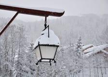 Lantern in snowy landscape Stock Image