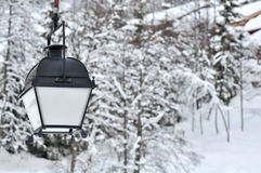 Lantern in snowy landscape Royalty Free Stock Image