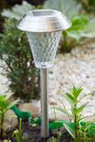 A solar-powered lamp in the garden royalty free stock image